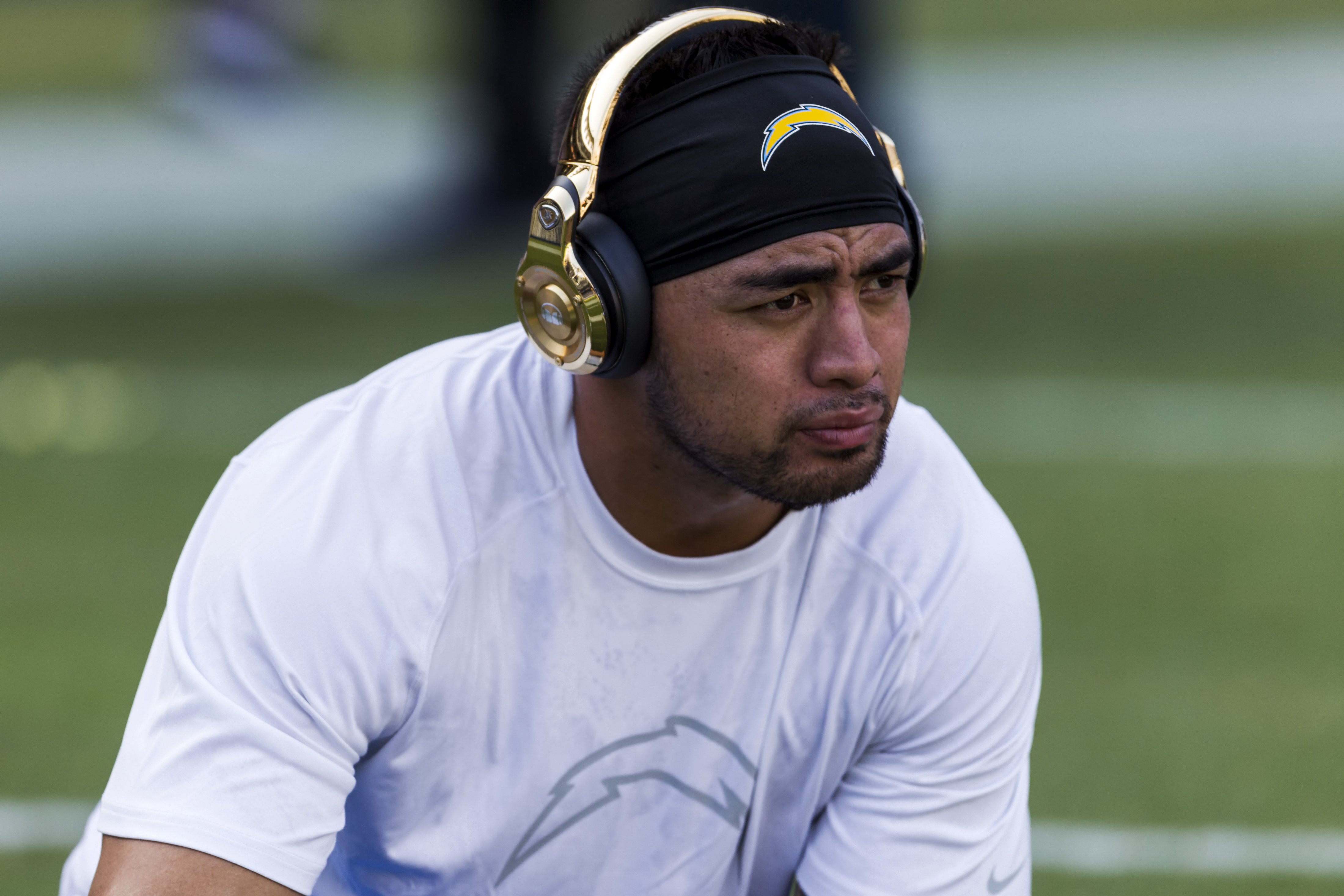 San Diego Chargers inside linebacker Manti Te'o stretches before the first preseason game between the Dallas Cowboys and the San Diego Chargers at Qualcomm. Photo by Bill Reilly