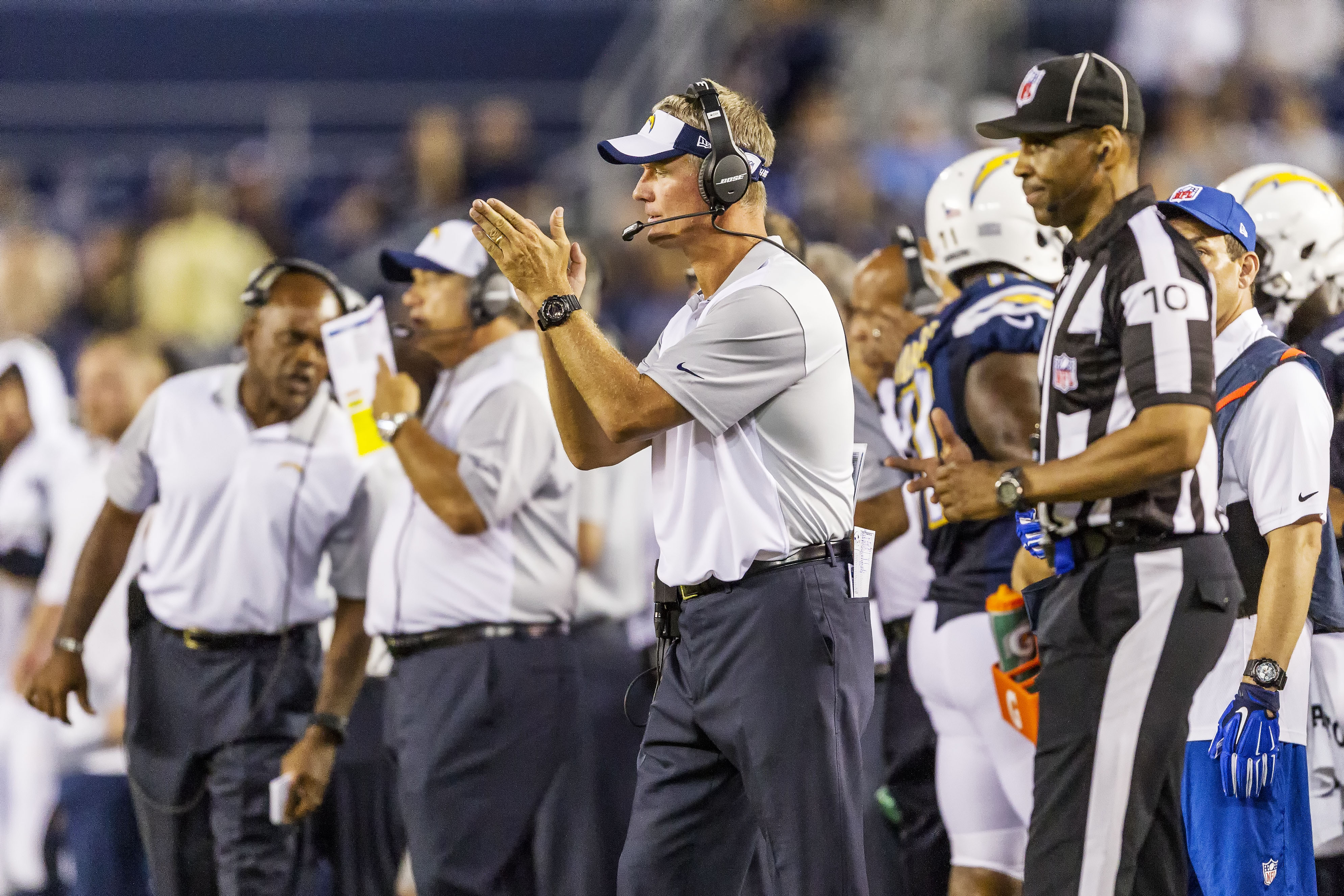 San Diego Chargers head coach Mike McCoy provides encouragement after the team recovered a Dallas Cowboys' fumble. Photo by Bill Reilly