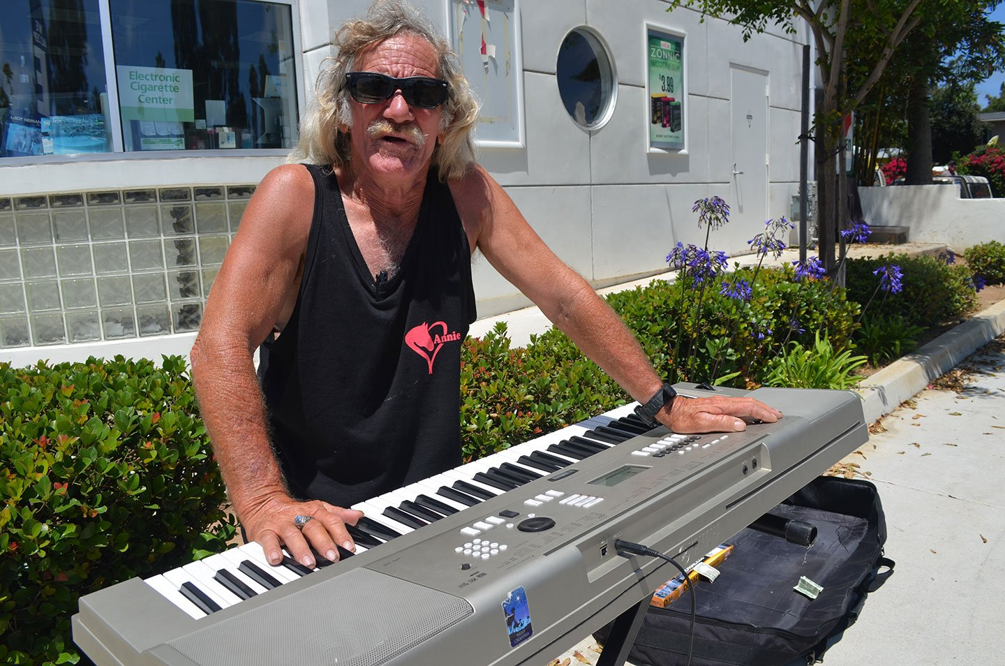 "Daniel ""Smitty"" Zeke practices his battery-powered Yamaha keyboard out front of the 7-Eleven along Coast Highway 101 in Leucadia. Photo by Tony Cagala"