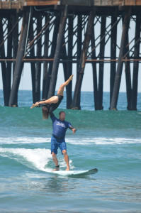 Encinitas tandem surfers Ahlia Hoffman and Travis Long perform a lift. Photo by Tony Cagala