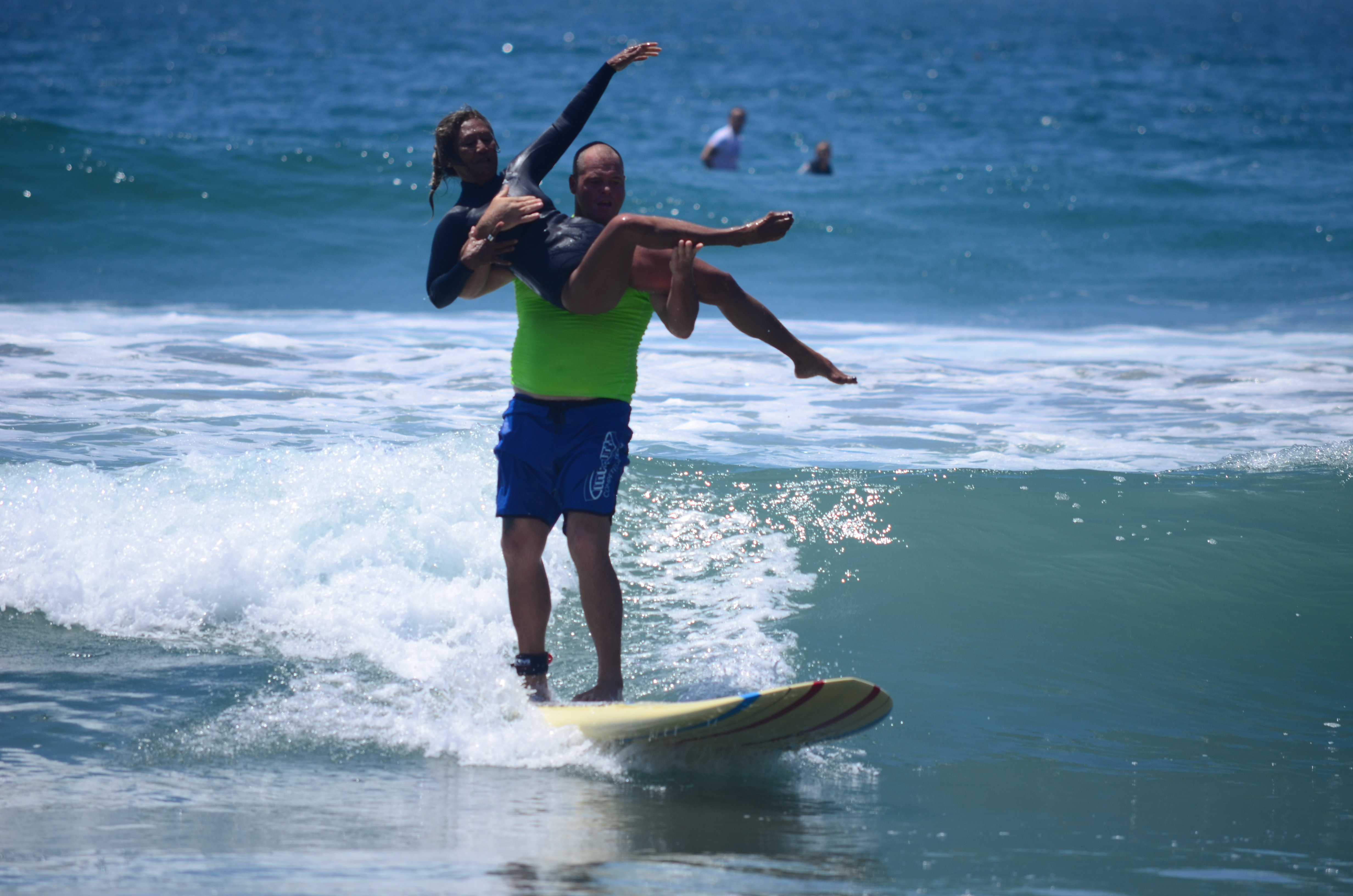 Surfers perform a lift during the amateur tandem surfing contest. Photo by Tony Cagala