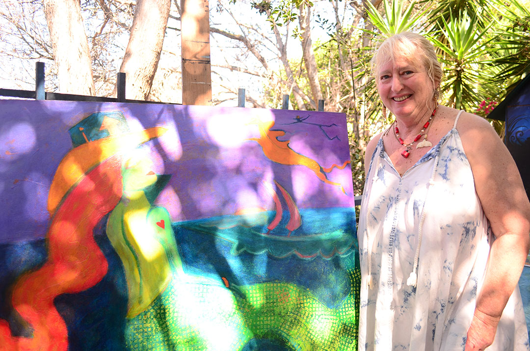 Encinitas artist Donna Butnik displays one of her paintings. Photo by Tony Cagala
