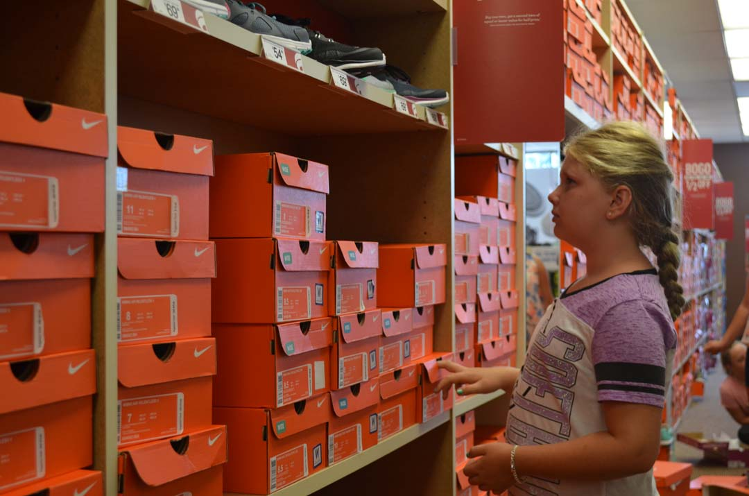 Peyton Christienas looks for the right pair of shoes for her. Photo by Tony Cagala