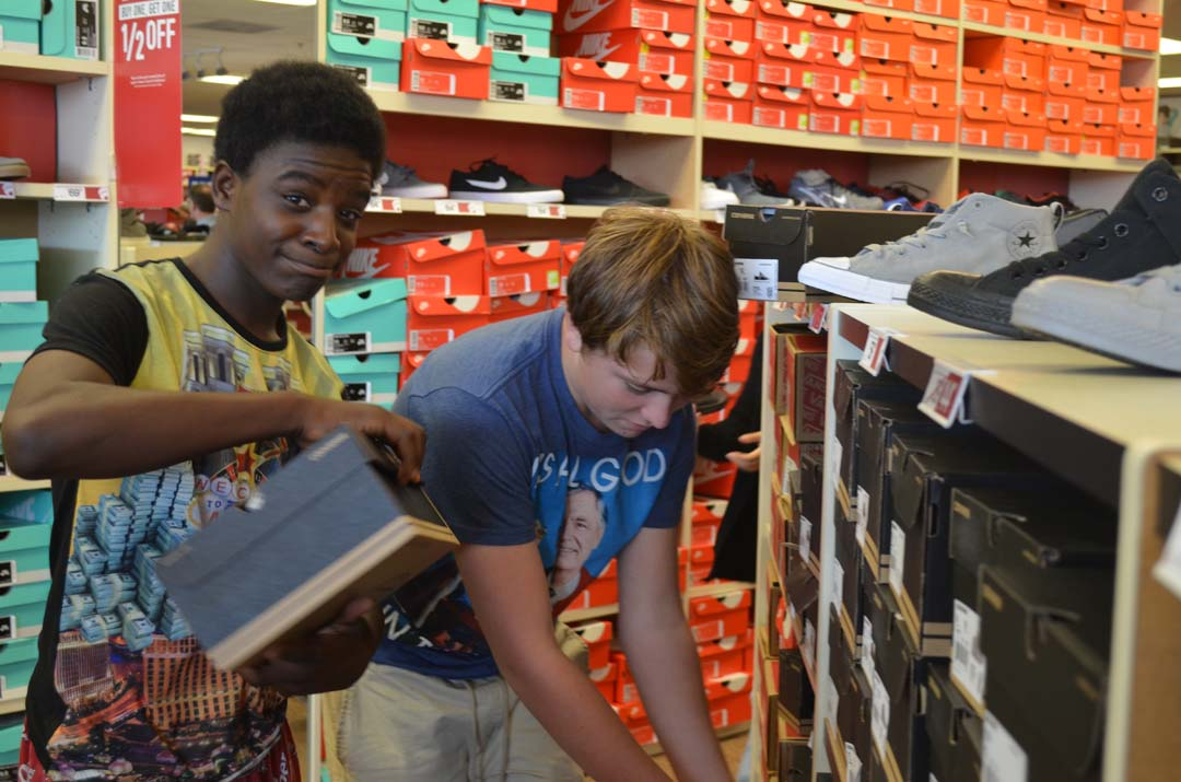 Rico Dixon, left, checks out a pair of Converse with his friend Patrick Watkins. Photo by Tony Cagala