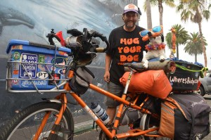 Mike Minnick and Bixby stop in Encinitas on Monday before continuing their more than two-year adventure of riding their bike across the country. Photo by Tony Cagala