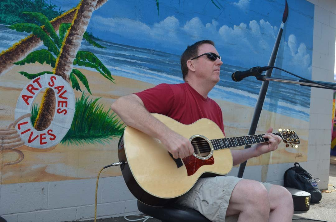 Musician Peter Hall performs at the Art Walk. Photo by Tony Cagala