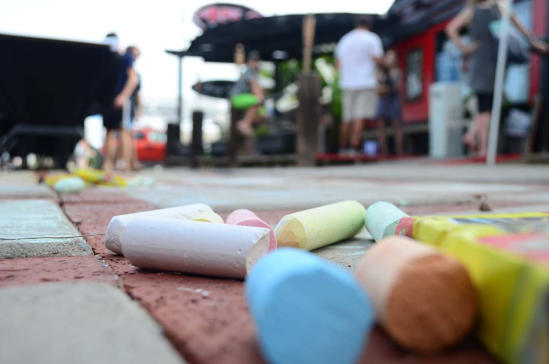 Anyone passing by could pick up a piece of chalk and take part in some sidewalk art near 454 Tattoo in Leucadia on Sunday. Photo by Tony Cagala