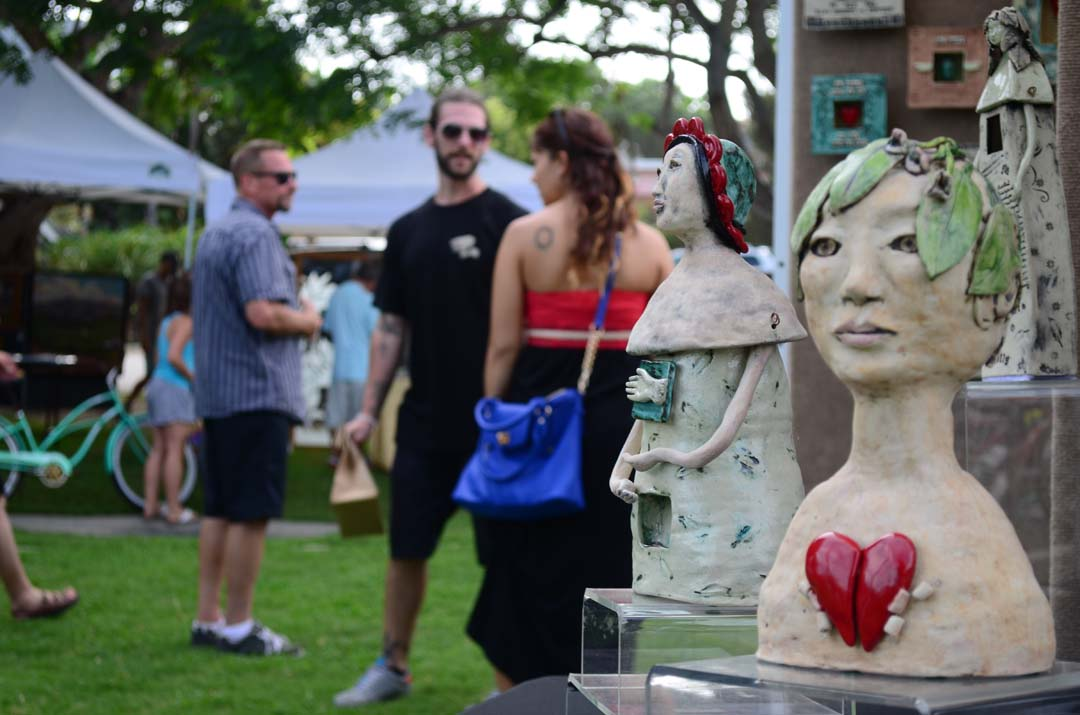 Patrons take in art from nearly every medium, including the sculptures from artist Carla Funk. Photo by Tony Cagala