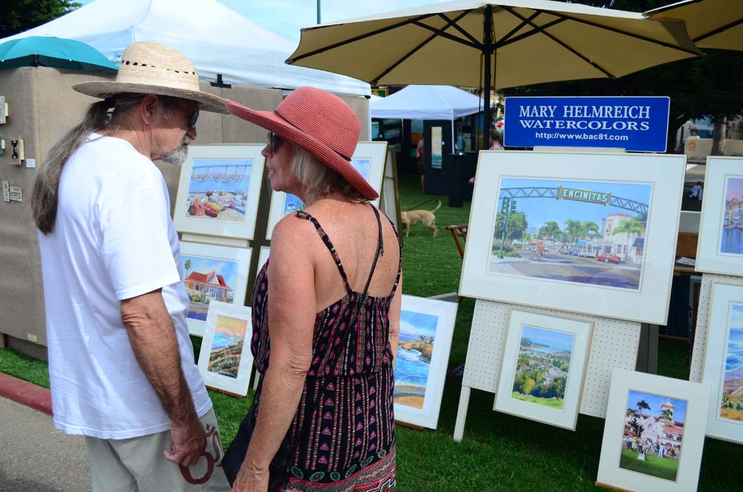A couple views some very familiar Encinitas locales-turned watercolor by artist Mary Helmreich. Photo by Tony Cagala