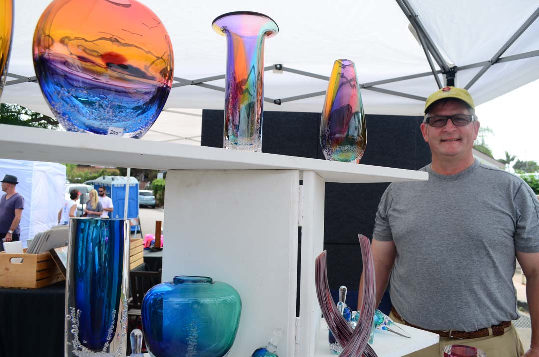 Encinitas City Council member Tony Kranz hosts his brother-in-law, Buzz Blodgett's, fine blown glass booth on Sunday. Photo by Tony Cagala