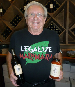 Fred Renzoni playfully promotes Robert Renzoni Marinara Sauce and a 2012 Sangiovese at the vineyard in Temecula. Photo by Frank Mangio