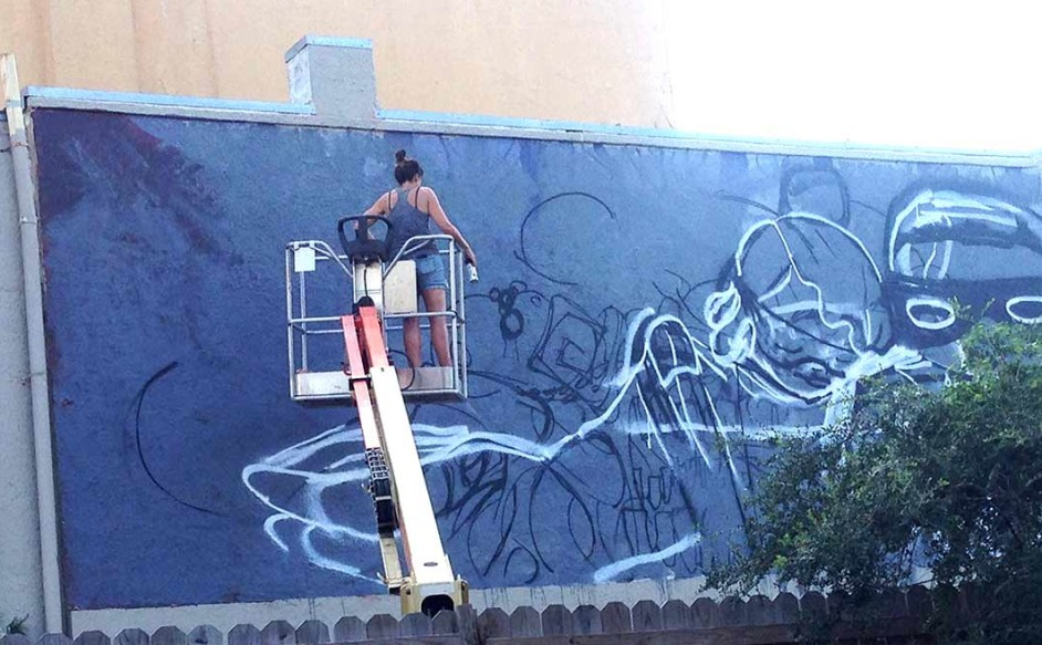 Artist Casey O'Connell paints a mural in New Orleans on her USA mural tour. Over the weekend she'll install a 25-foot mural on the south wall of the Historic 1920's Art Deco building at 970 N. Coast Highway 101 during the LeucadiArtWalk. Courtesy photo