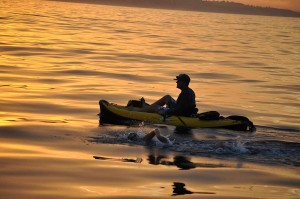 The Ocean's Seven swim team crossed the channel between Catalina and Rancho Palos Verdes Friday night during a team relay. Here, Coach Rob Mackle guides one of the swimmers in a kayak during the seven hour and 51 minute journey. Courtesy photo