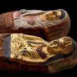 CT scanning of these two beautifully gilded and decorated mummies of Ptolemaic Egypt reveal a sister and a brother, both about 11 years old. (Photo by John Weinstein)