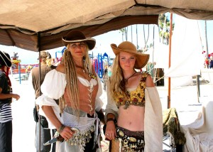 Pirates Dana Burris and Addie Burris greet visitors to the pirate village. About 40 pirates took part in cannon and sword skirmishes. Photo by Promise Yee