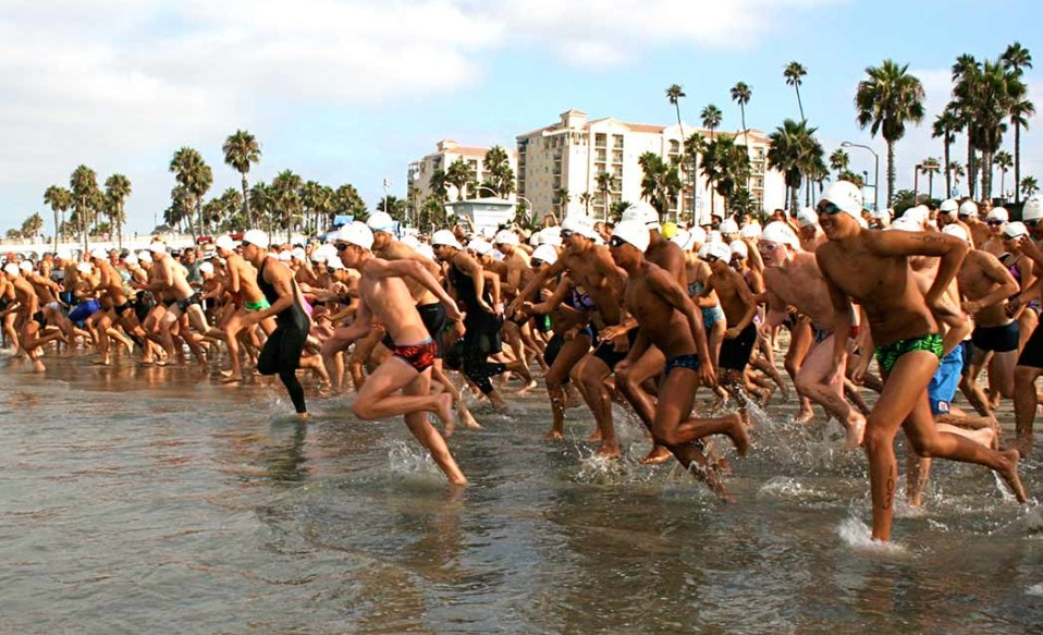 Hundreds participate in the annual swim around Oceanside Pier. The race also serves as a fundraiser for the Oceanside Swim Club. Photo by Promise Yee