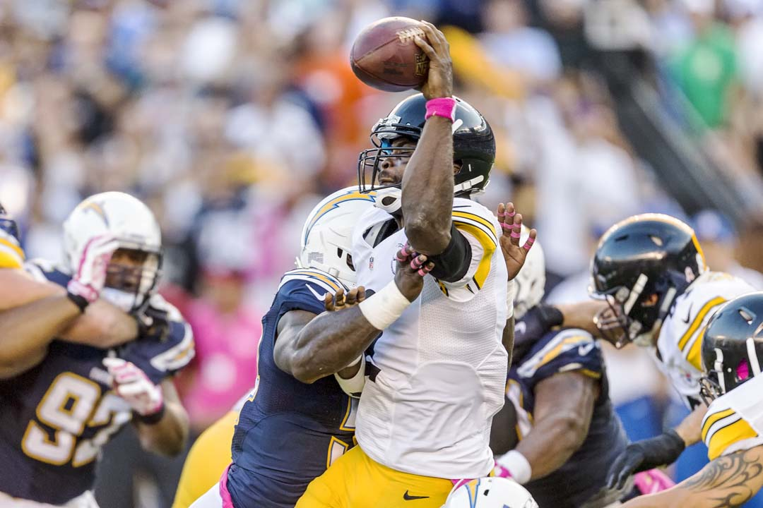 San Diego Chargers outside linebacker Melvin Ingram (54) makes contact with Pittsburgh Steelers quarterback Mike Vick (2) during the first quarter. Vick's pass went incomplete. Photo by Bill Reilly