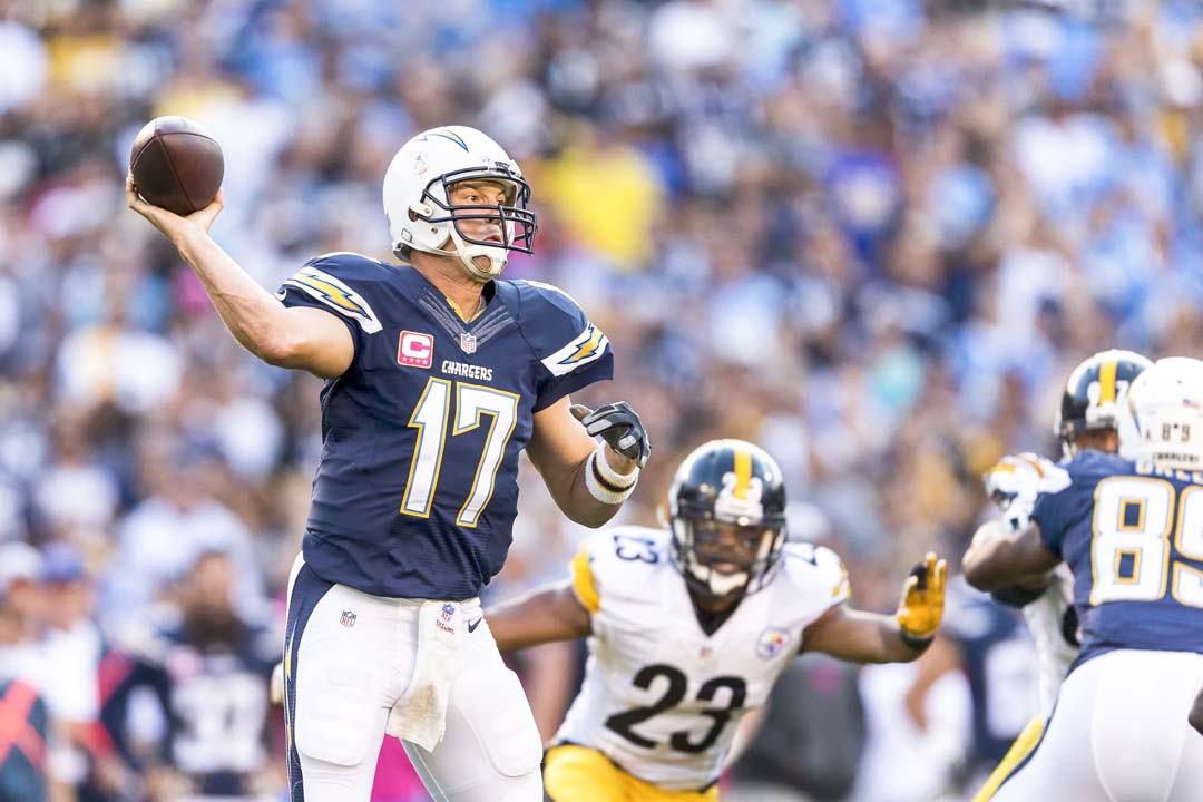 San Diego Chargers quarterback Philip Rivers (17) attempts a pass downfield while being pressured by Pittsburgh Steelers safety Mike Mitchell (23). Photo by Bill Reilly