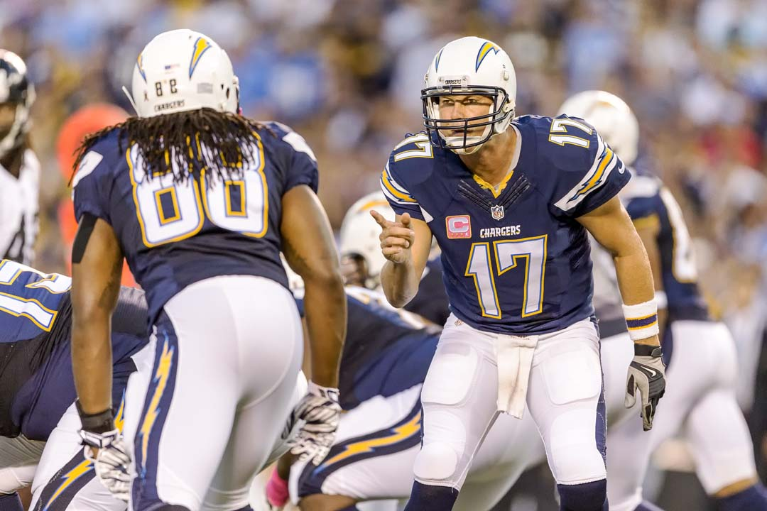 San Diego Chargers quarterback Philip Rivers (17) changes the play at the line of scrimmage and specifically calls out tight end David Johnson (88). Photo by Bill Reilly
