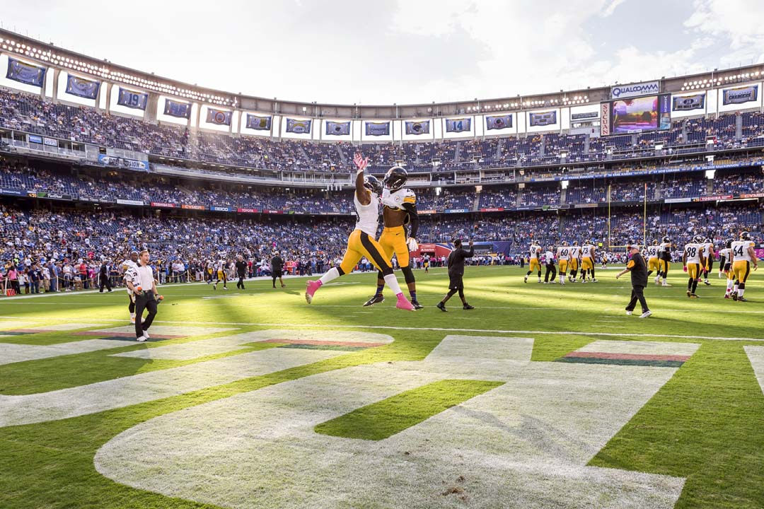 The Pittsburgh Steelers take to the field for pre-game activities at Qualcomm Stadium on Monday night. Photo by Bill Reilly
