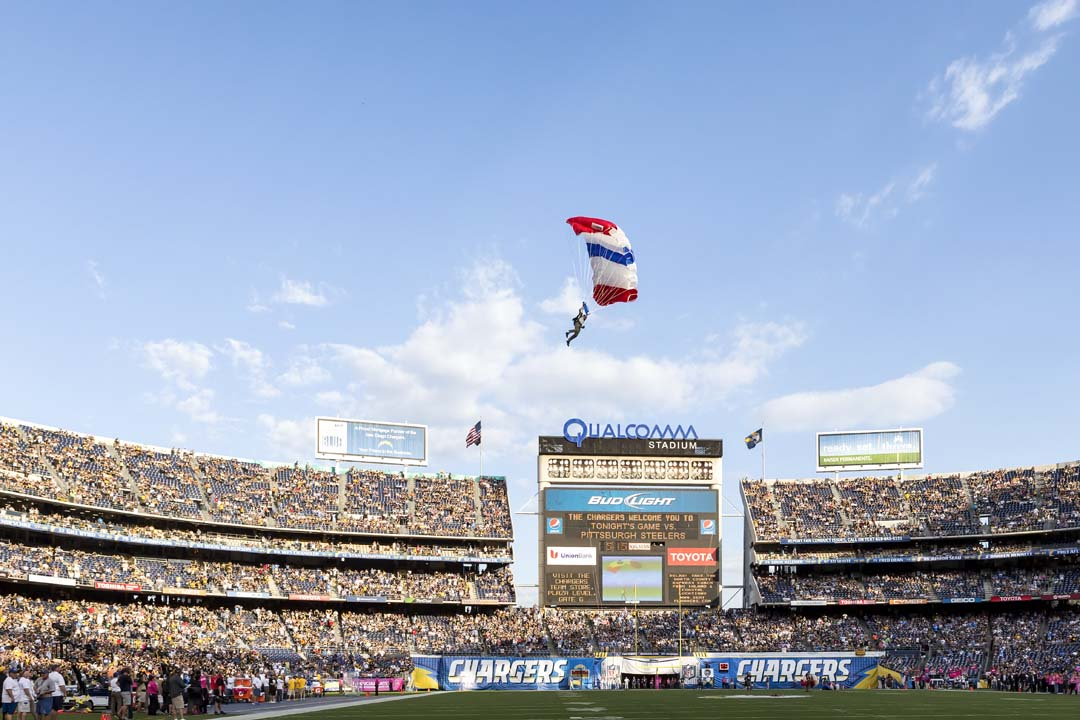 A member of the Frog-X parachute team prepares to land at Qualcomm Stadium during pre-game activities prior to Monday night's game between the Steelers and Chargers. Photo by Bill Reilly