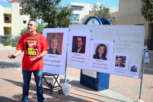 Darel Engen, a history professor and president of the Cal State San Marcos chapter of the faculty association, explains why faculty members are seeking a 5 percent salary increase. Photo by Tony Cagala