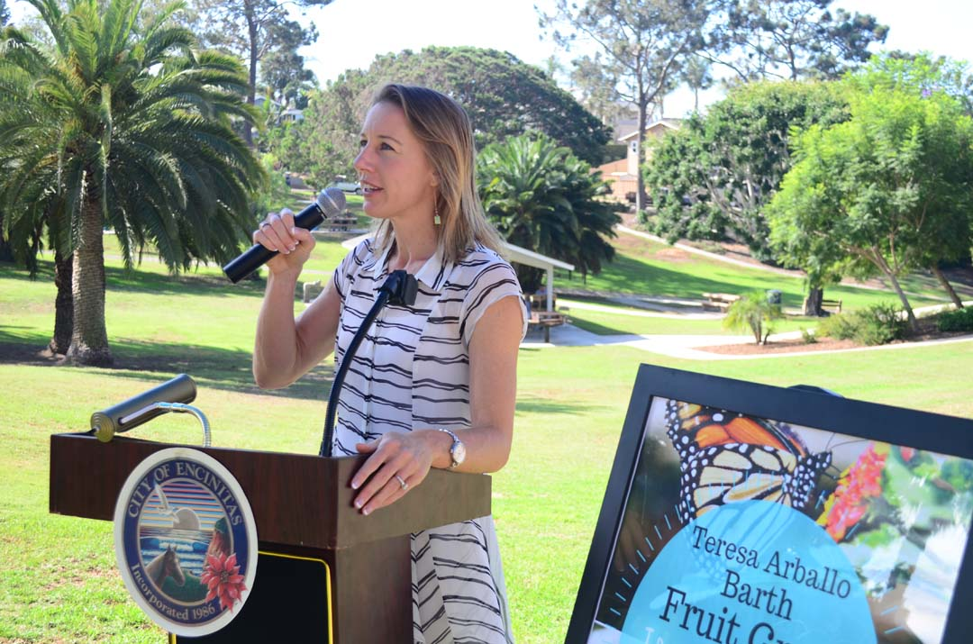 Encinitas Deputy Mayor Catherine Blakespear makes opening remarks during the naming and planting of the Teresa Arballo Barth Fruit Grove ceremony on Saturday. Photo by Tony Cagala