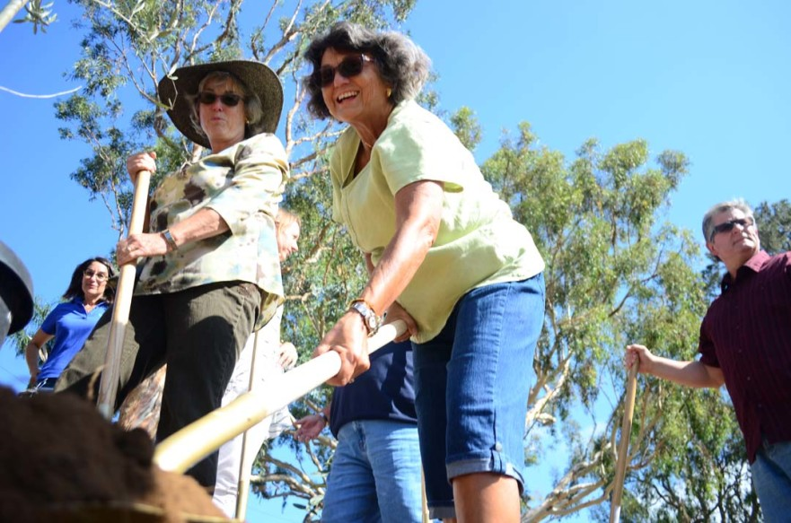 Teresa Barth, right, with Encinitas City Council member Lisa Shaffer dig a spot for an olive tree. Photo by Tony Cagala