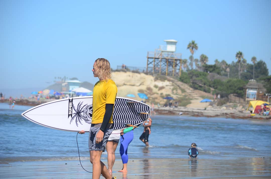 Jade Morgan, riding for Hansen's Surf Shop, surveys the waves before paddling out in the Cardiff Surf Classic. Photo by Tony Cagala