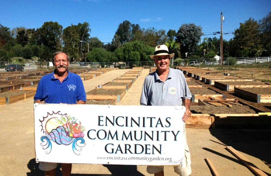 Doug Long, left, and Gordon Smith, president of the Encinitas Community Garden's nonprofit board ready the city's community garden, the first of its kind, for its debut Saturday. Photo by Aaron Burgin
