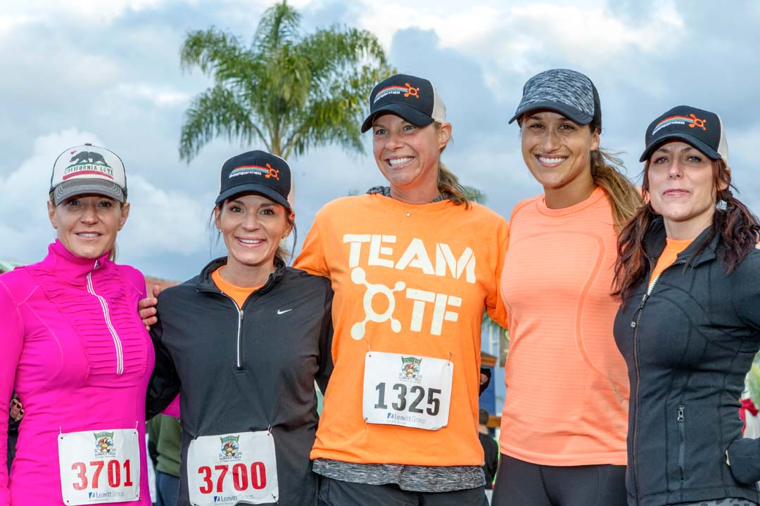 Race participants pose for a group photo prior to the start of the Encinitas Turkey Trot. Photo by Bill Reilly