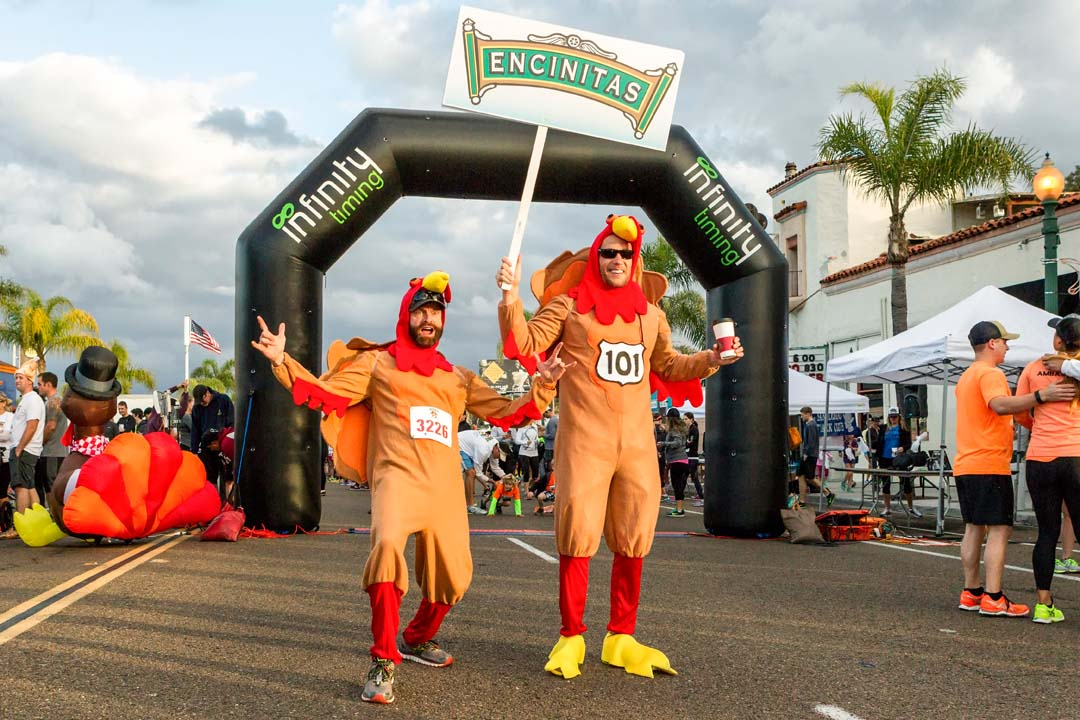 Race participants have some fun prior to the start of the Encinitas Turkey Trot. Photo by Bill Reilly