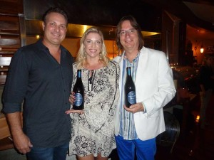 Tucker and Sarah Spear, left, bring their new Preston Parker wines to Randy Smerik and his Solare Ristorante in San Diego. Photo by Frank Mangio