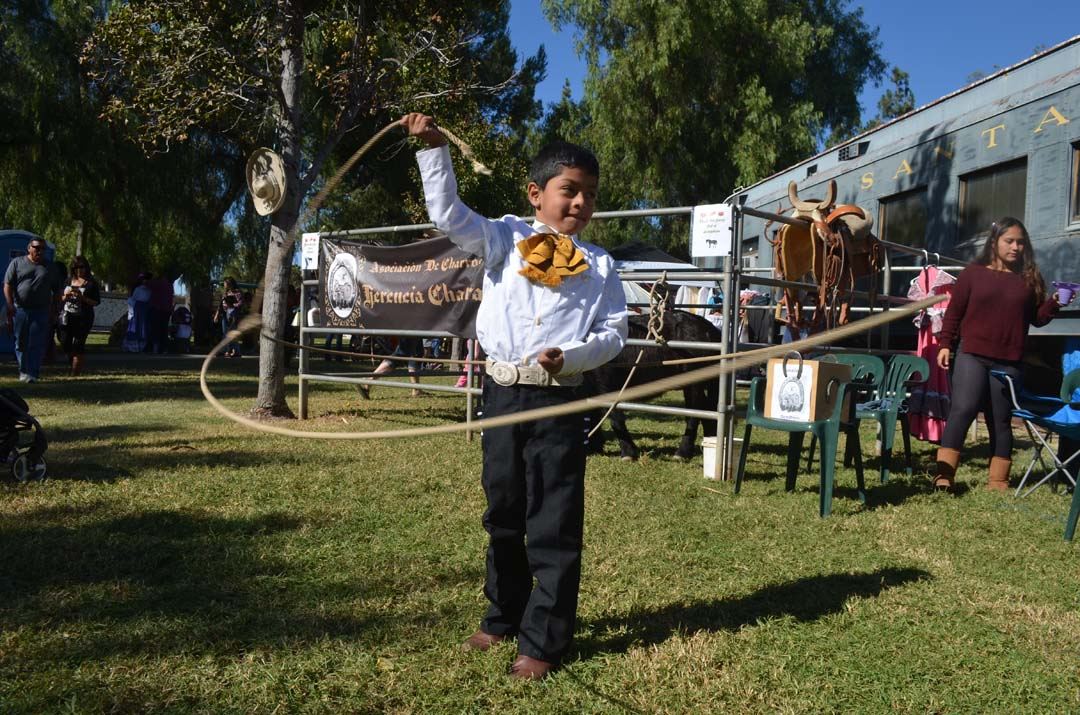 Alexander Noyola of the Herencia Charra de Escondido performs a lasso maneuver. Photo by Tony Cagala