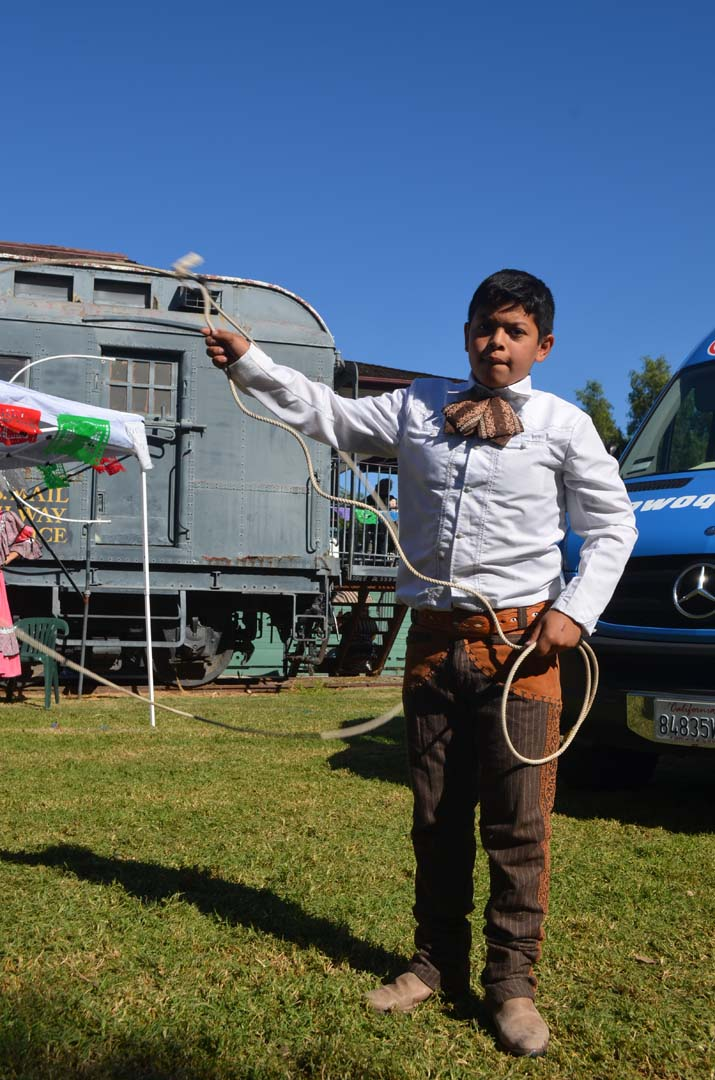 John Noyola shows off some trick roping at the Escondido Tamale Festival. Photo by Tony Cagala