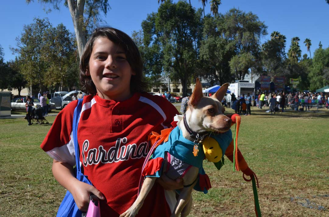 Cooper McKillip with his dog Cookie, dressed as a piñata, before the Chihuahua costume contest. Photo by Tony Cagala