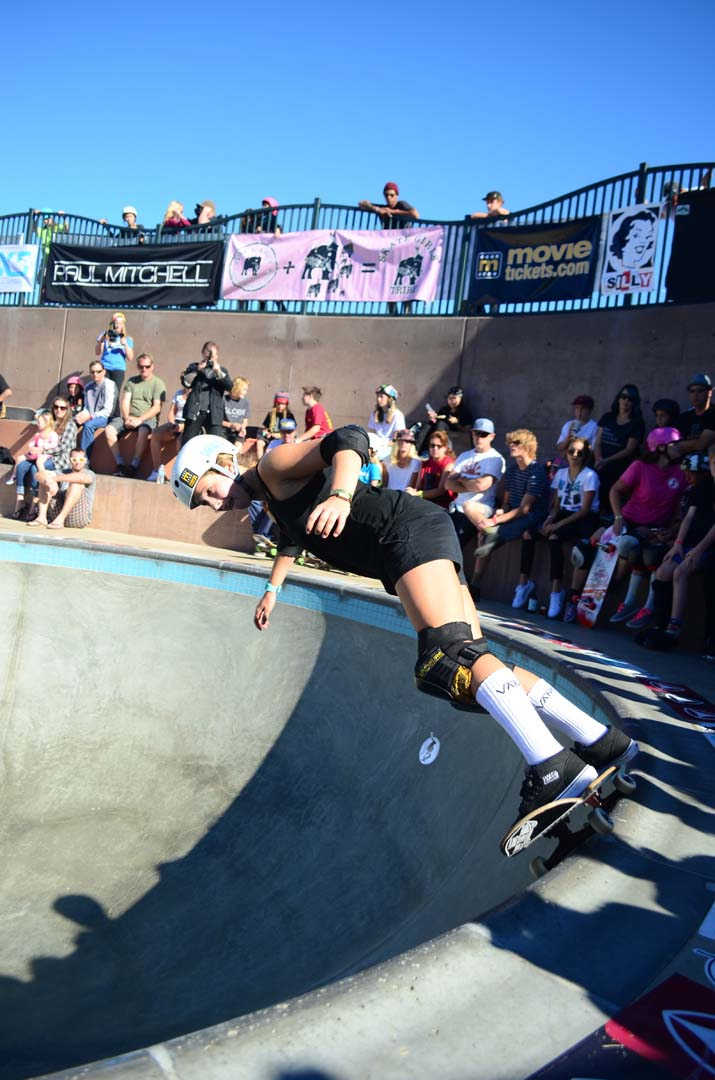 A skater performs a 50-50 grind along the rim of the bowl. Photo by Tony Cagala