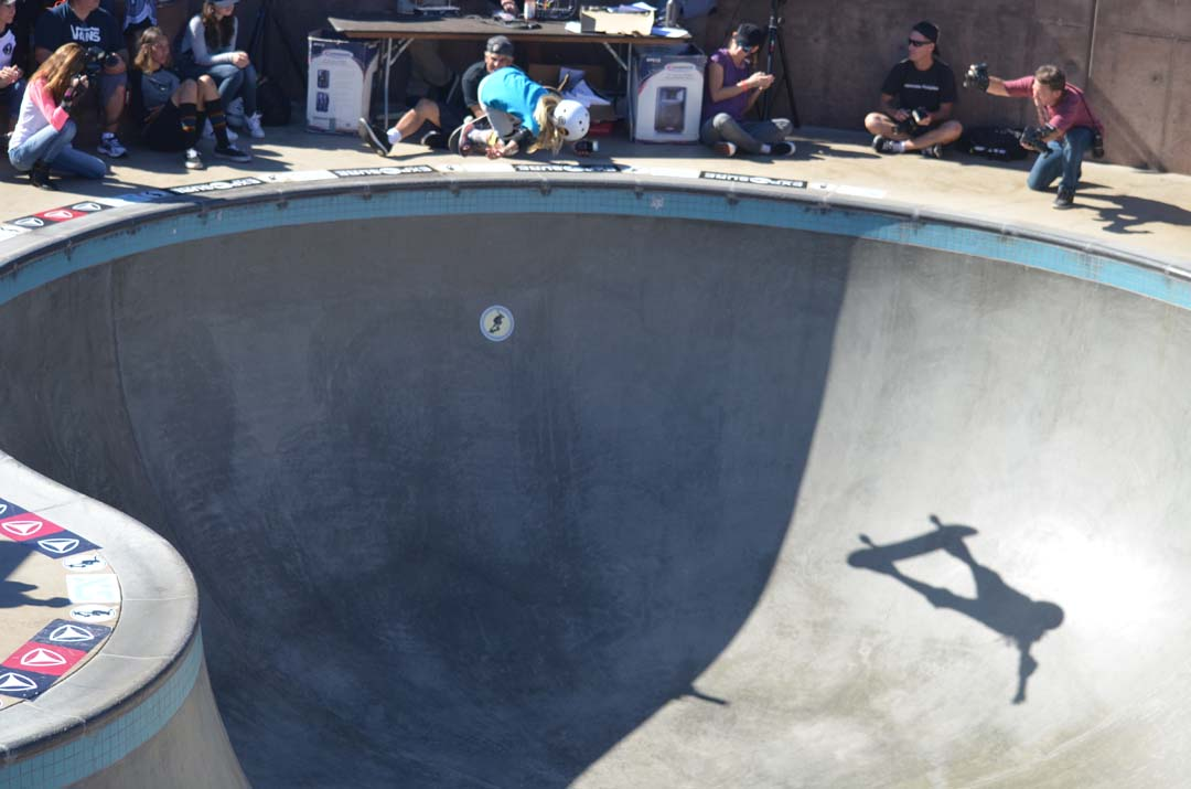 A young skater catches air in the bowl. Photo by Tony Cagala