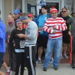 Where's Waldo? Cyrous Sheikh stands out in a crowd dressed as the Waldo character before the 10th annual Oceanside Turkey Trot begins. Photo by Tony Cagala