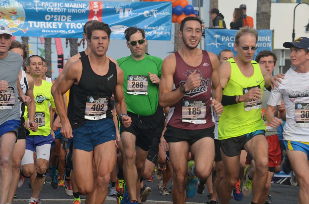 Racers sprint out of the starting line during the 5K portion of the Oceanside Turkey Trot. Photo by Tony Cagala