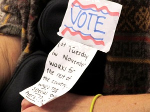 A woman wears a ribbon Tuesday showing support for the 85/15 plan to be placed on the Nov. 8, 2016, general election ballot. Photo by Steve Puterski