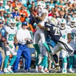 San Diego Chargers cornerback Craig Mager (29) pushes a Miami Dolphins receiver out of bounds in front of the Dolphins bench. Photo by Bill Reilly