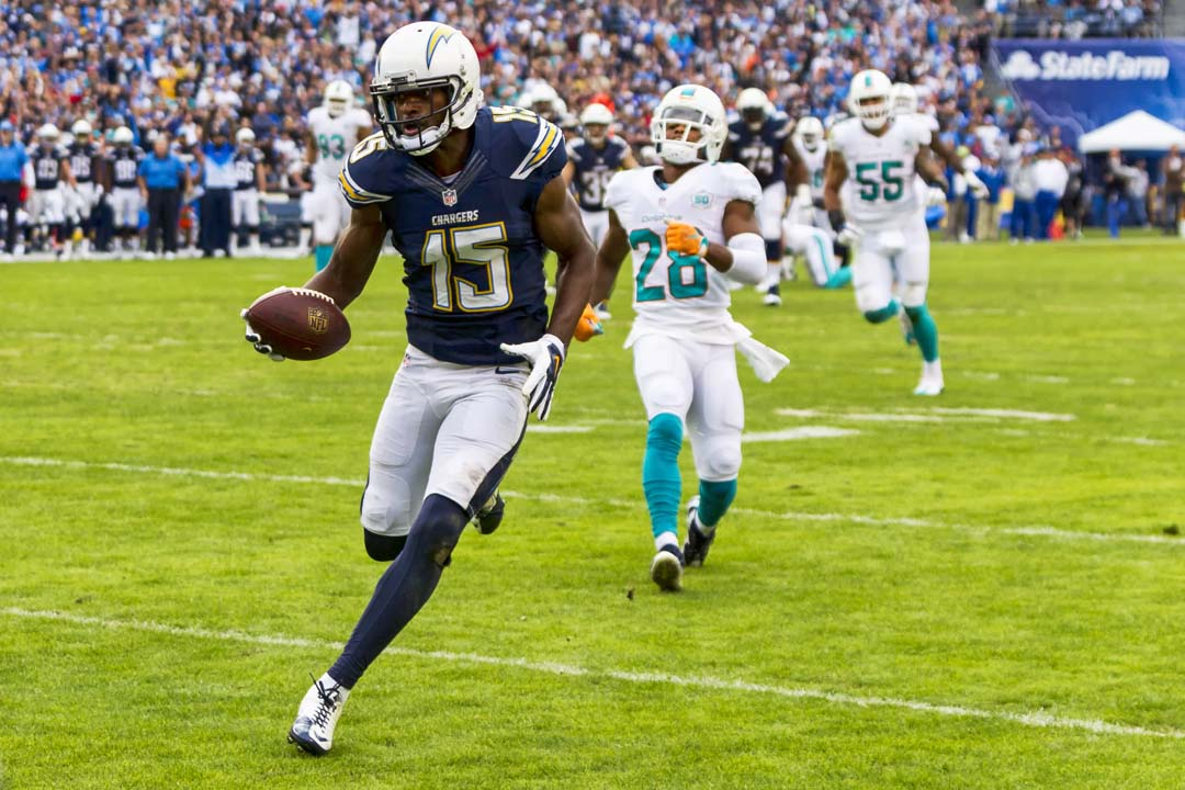 San Diego Chargers wide receiver Dontrelle Inman (15) catches a pass in front of Miami Dolphins cornerback Bobby McCain (28).