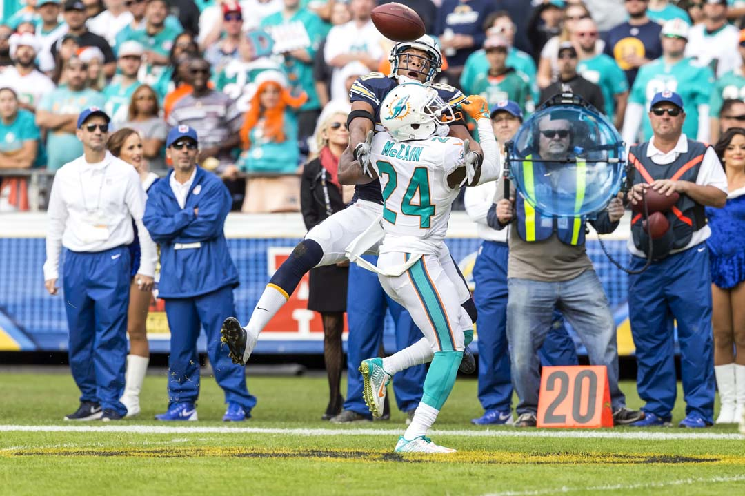 Miami Dolphins cornerback Brice McCain (24) breaks up a pass intended for San Diego Chargers wide receiver Malcolm Floyd (80). Photo by Bill Reilly