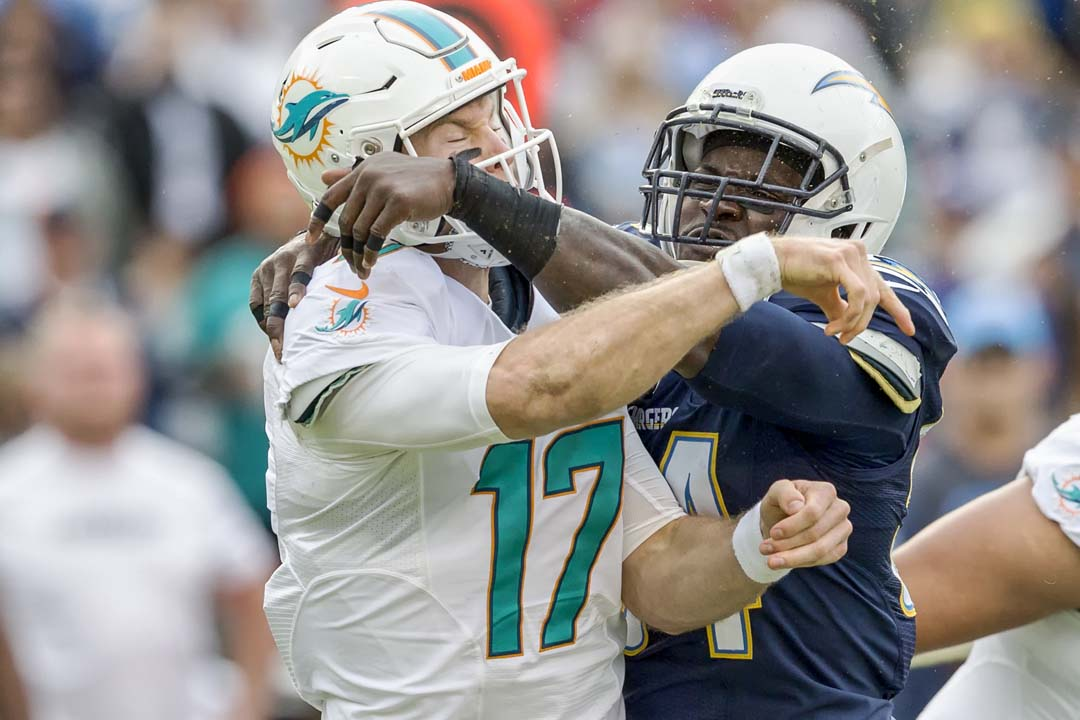 San Diego Chargers outside linebacker Melvin Ingram (54) gets in the face of Miami Dolphins quarterback Ryan Tannehill (17) in the second quarter. Photo by Bill Reilly