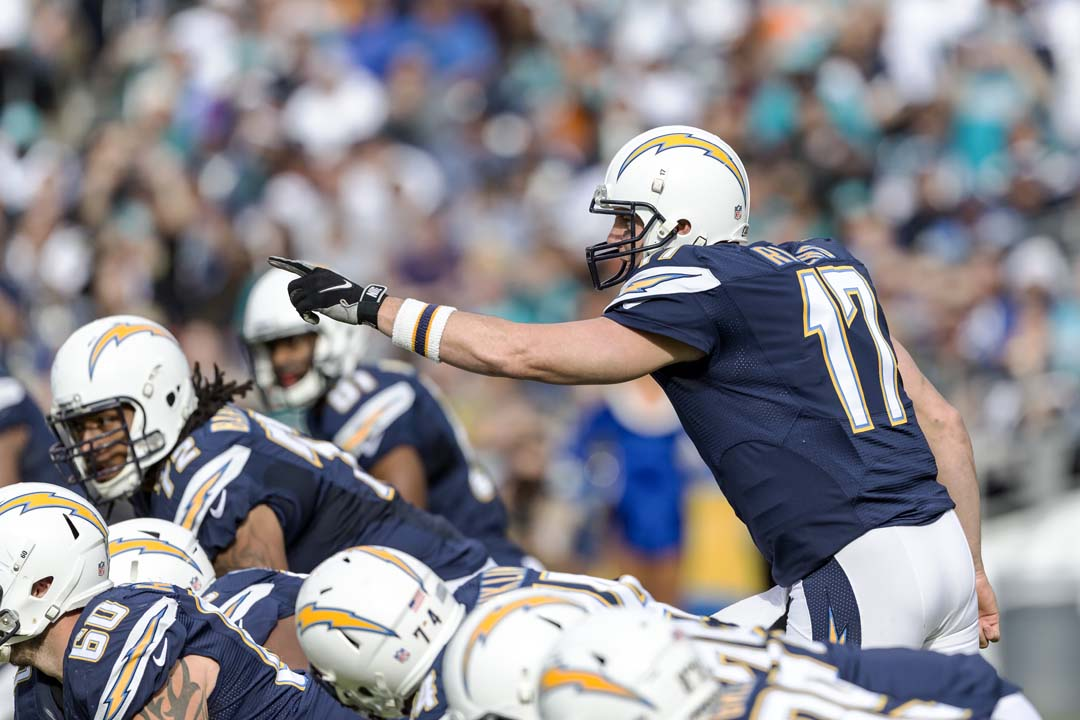 San Diego quarterback Philip Rivers (17) identifies the defensive coverage of the Miami Dolphins to his offensive line. Photo by Bill Reilly