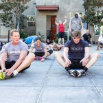 SEALFIT Founder and CEO Mark Divine, left, Matthew Reeve, right and other participants join together on the grinder for a workout that supports spinal cord research. Photo by Bill Reilly