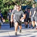 Participants in the Reeve WOD perform exercises on the grinder. Photo by Bill Reilly
