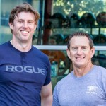 Matthew Reeve, left, and SEALFIT coach and former Navy SEAL Mark Curtis take a break from the workout. Photo by Bill Reilly