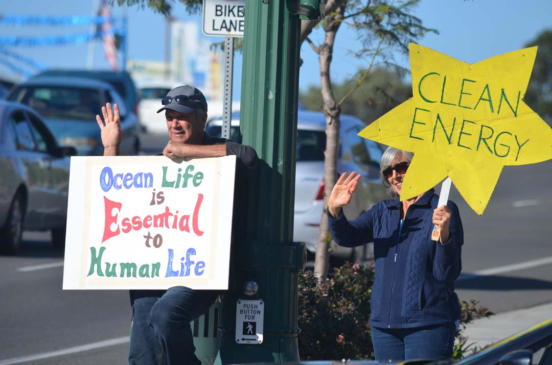 People attend a rally on Sunday in Encinitas to show support for the climate change talks happening this week in Paris, France. Photo by Tony Cagala